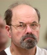 Convicted BTK killer Dennis Rader listens during a court proceding Wednesday, Oct. 12, 2005, at the El Dorado Correctional Facility in El Dorado, Kan. A judge recommended Wednesday that Rader receive treatment as a sexual offender and have restrictions on what he can receive or do in prison while he serves the rest of his life in prison for 10 murders. (AP Photo/Travis Heying, Pool)